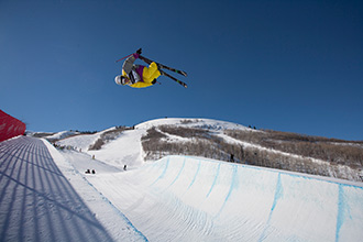 An athlete skiing down a halfpipe